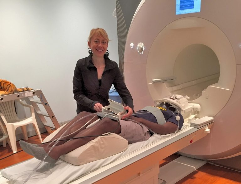 Researcher with participant in MRI